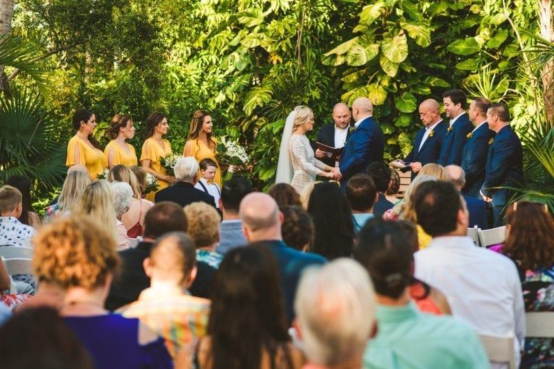 Couple exchanging wedding vows at hemingway house