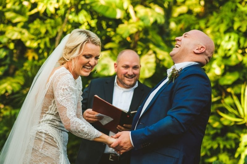 Couple laughing as they exchange vows at hemingway house