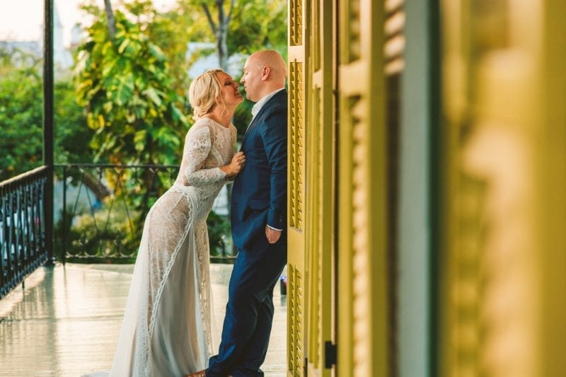 Bride and groom kissing after exchanging vows