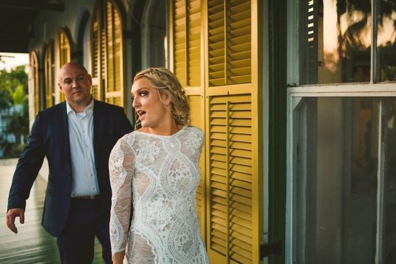Bride and groom walking down the halls of hemingway house