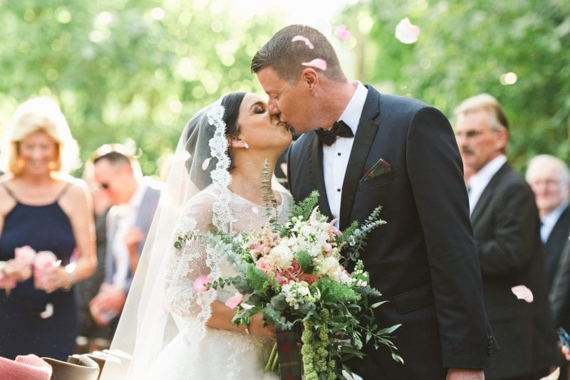 Bride and groom kissing after marriage ceremony at hemingway house