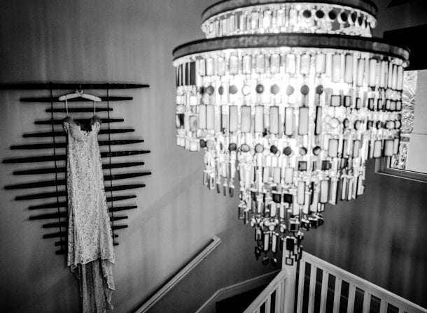 Large chandelier and dress hanging