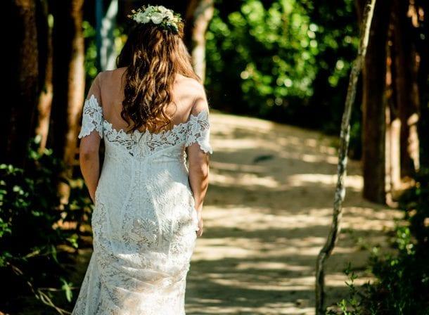 Bride in her dress walking along the sand in playa largo