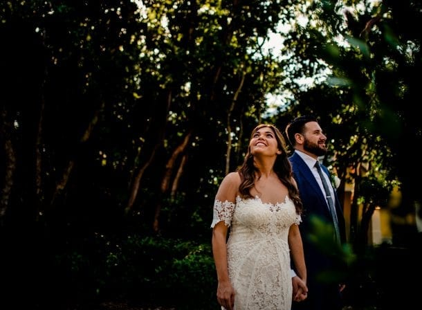 Bride and groom among the trees before wedding in playa largo