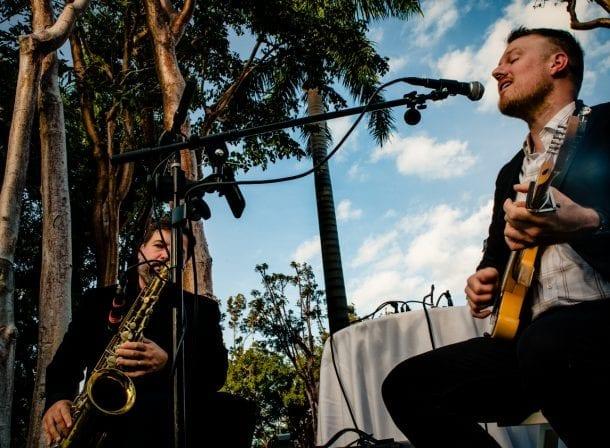 Man playing guitar and singing during wedding reception in playa largo