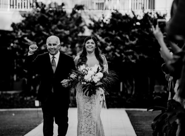 Father walking his daughter down the aisle in playa largo