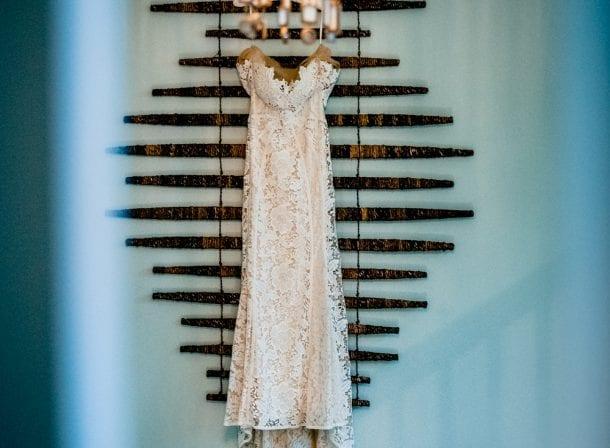 Bride's dress hanging in her hotel room