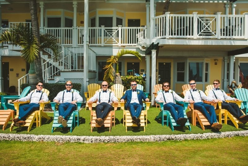 groomsmen sitting on chairs at at southernmost beach resort