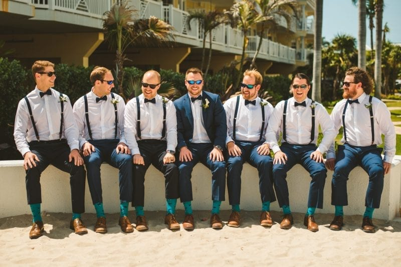 groomesmen sitting for portrait at southernmost beach resort
