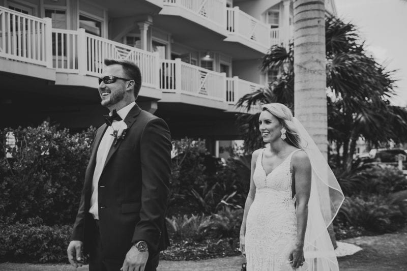 bride and groom walking the grounds at southernmost beach resort before wedding