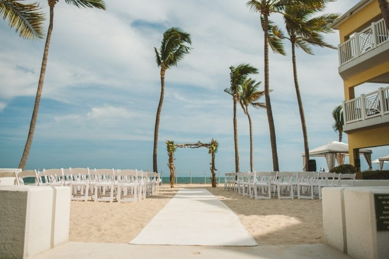 beach wedding chairs and aisle set up on at southernmost beach resort