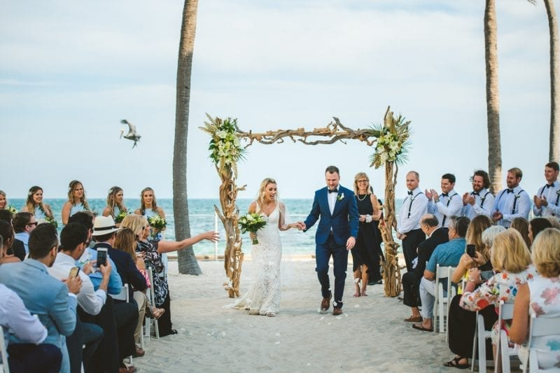 bride and groom walking down aisle after ceremony at southernmost beach resort