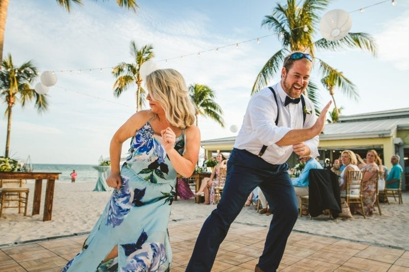 wedding party dancing at beach wedding at southernmost beach resort