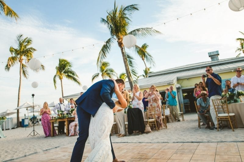 groom dipping bride after wedding vows at southernmost beach resort