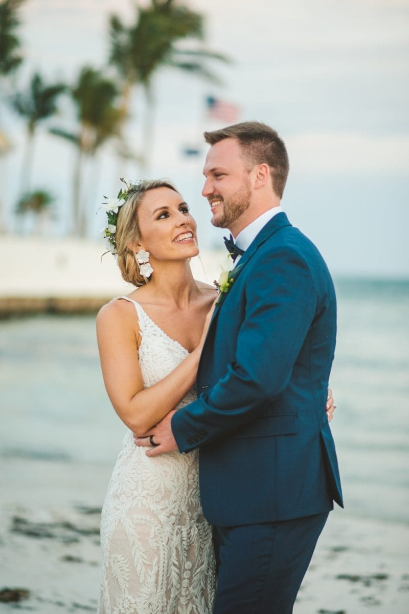 bride and groom smiling for a beach wedding portrait