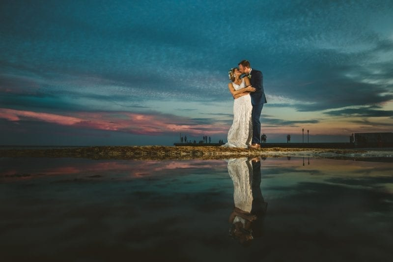 bride and groom portrait at sunset on the beach at southernmost beach resort