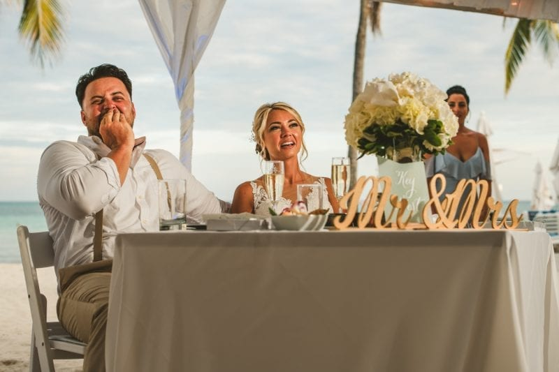 bride and groom at newlywed table for wedding reception at southernmost beach resort