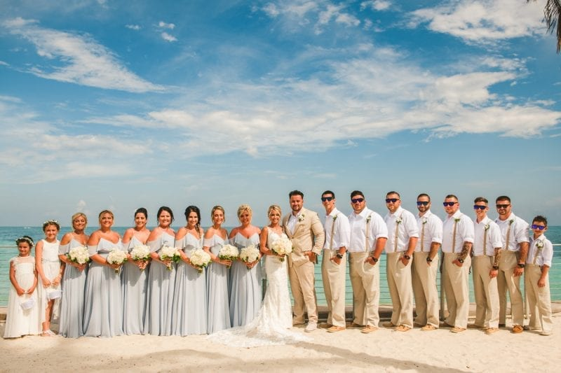 wedding party posing on the beach for portraits