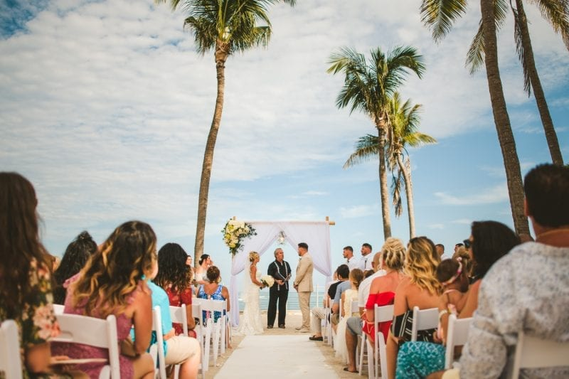 couple saying their vows during beach wedding at southernmost beach resort