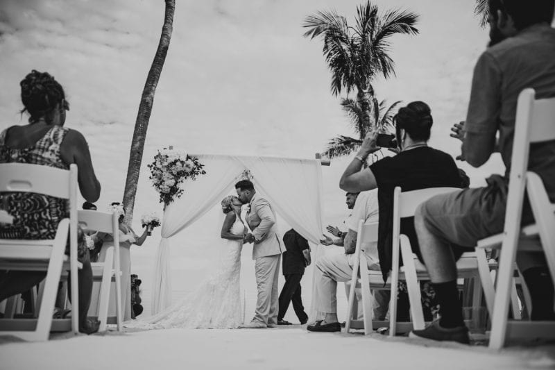 Bride and groom kissing after vows at southernmost beach resort