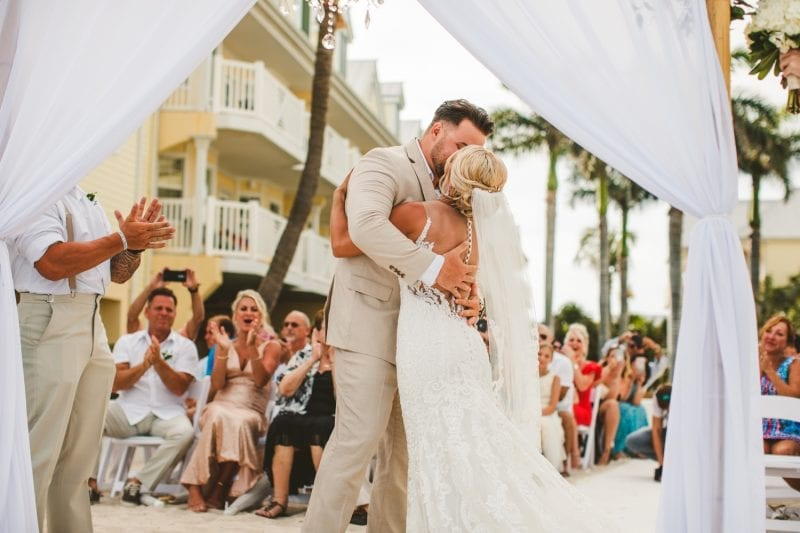 Bride and groom kissing after saying wedding vows at southernmost beach resort