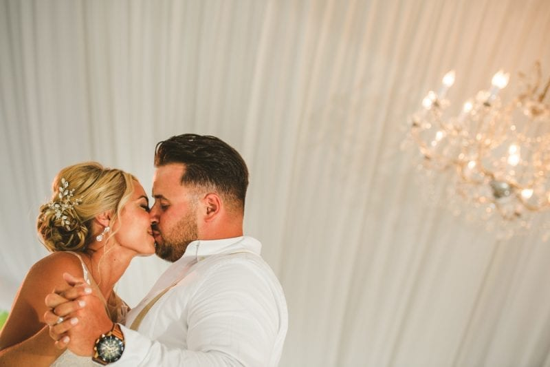 Bride and groom kissing for a portrait at southernmost beach resort