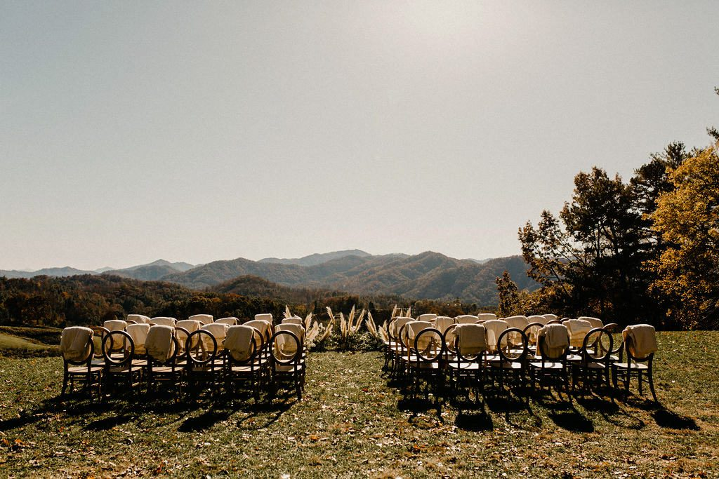 Chairs on grass at outdoor wedding venue The Ridge in Marshall NC.