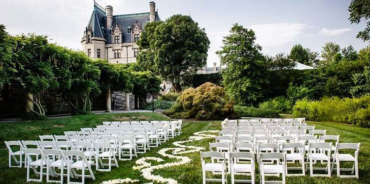 Chairs and roses arranged for an outdoor wedding at the Biltmore Estate.