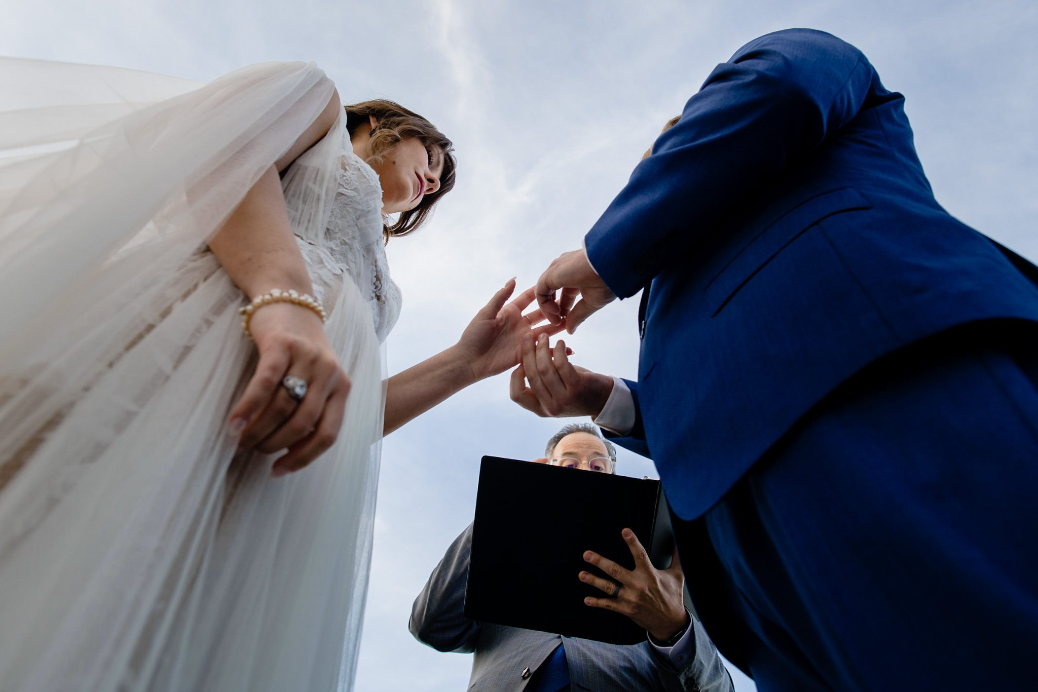 Closeup image of a couple exchanging rings during their elopement ceremony