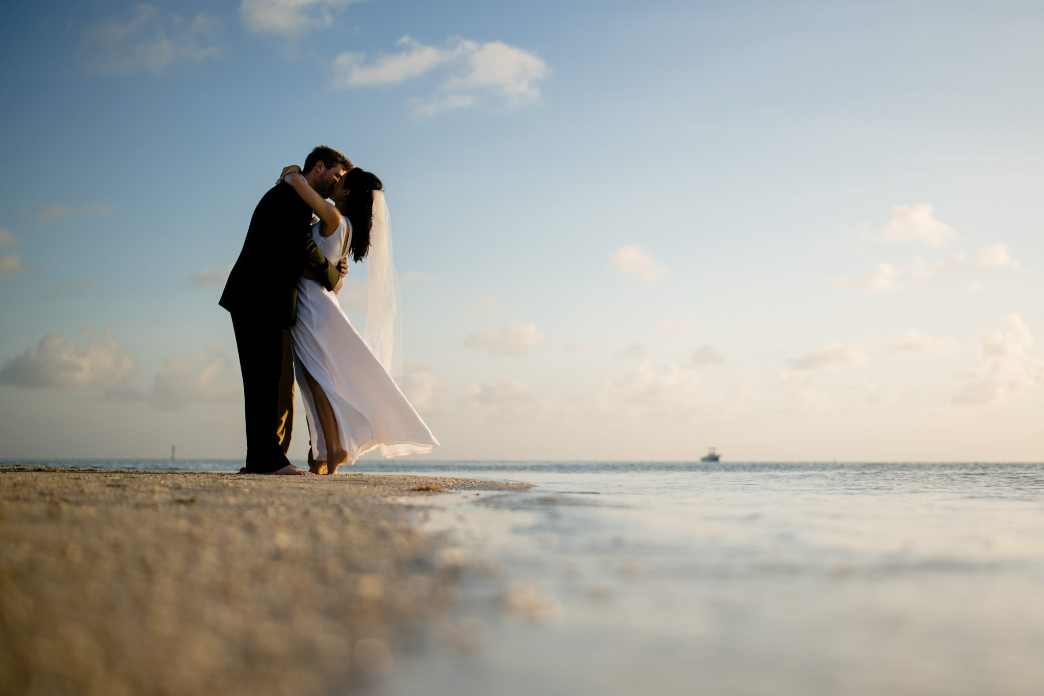 couple kissing after getting married in key west