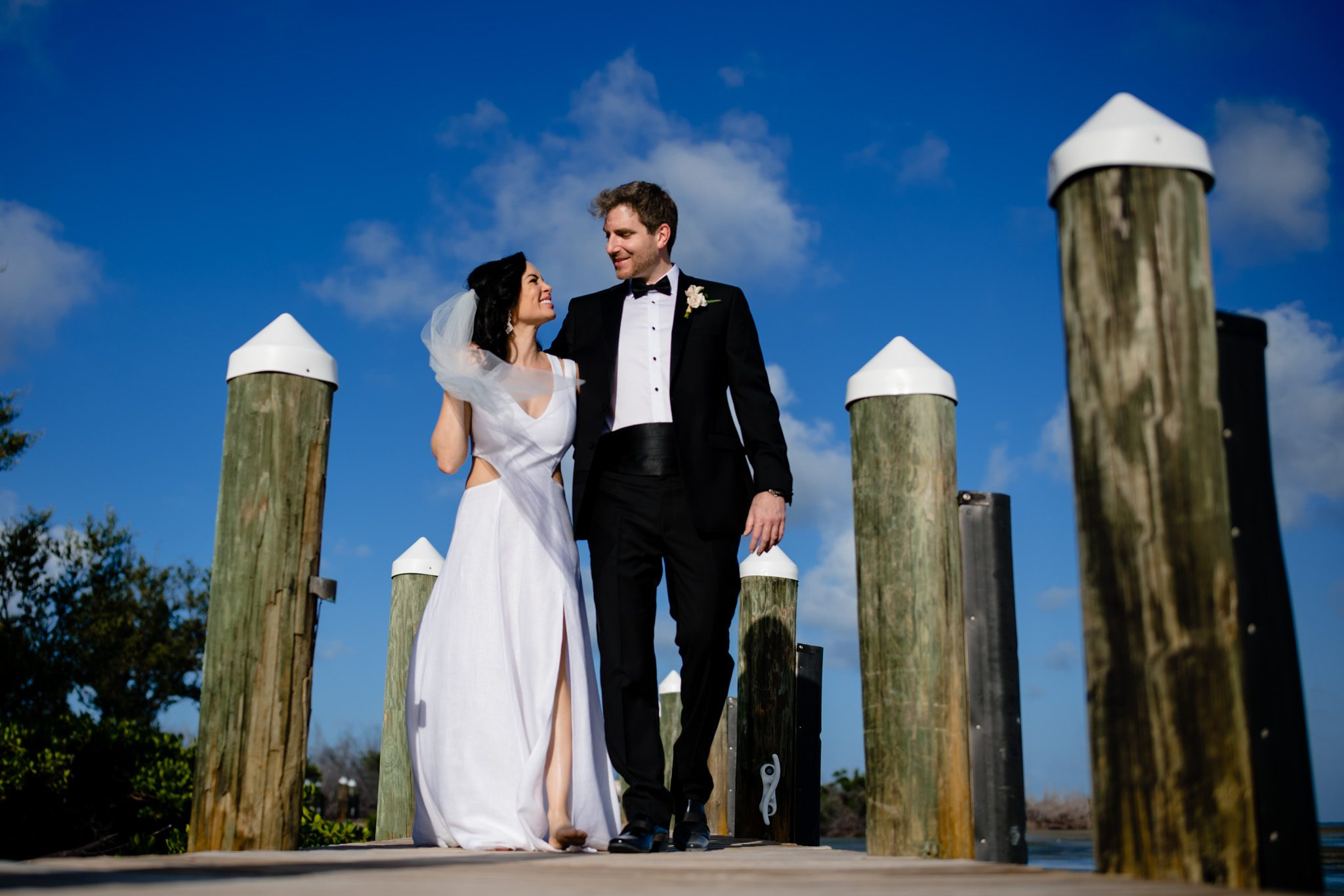 bride and groom walking down the dock at little palm island in key west