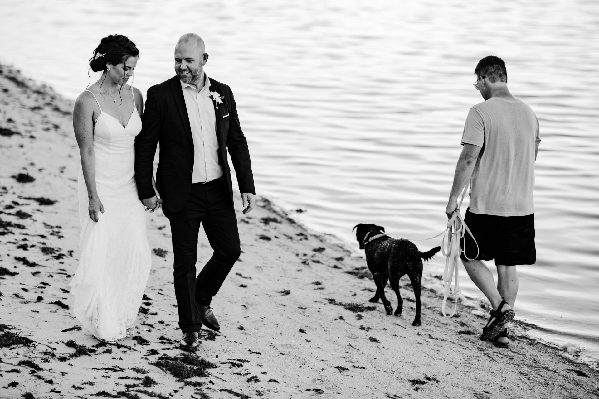Newly eloped couple walking on the beach at old town manor in key west.
