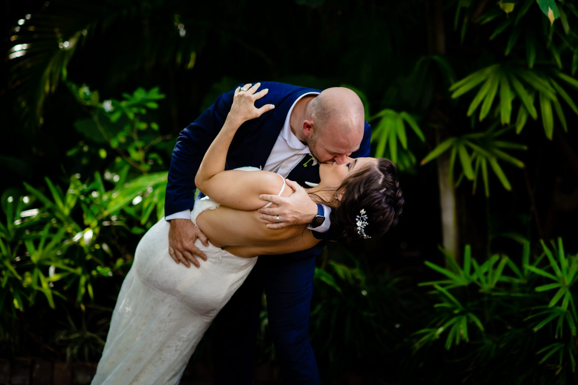 Bride and groom kissing after elopment at old town manor in key west.