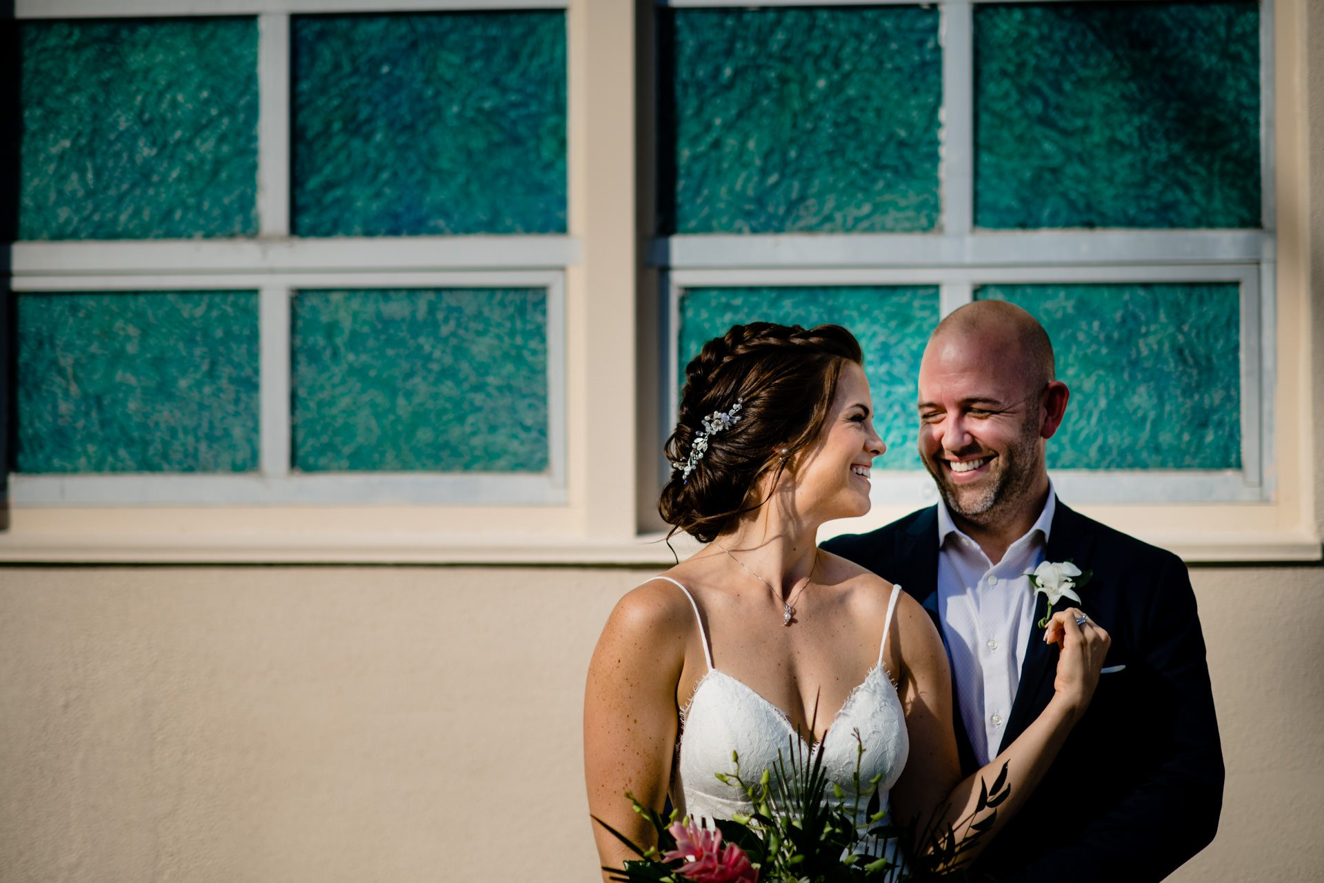Bride and groom smiling for a photo at old town manor in key west.