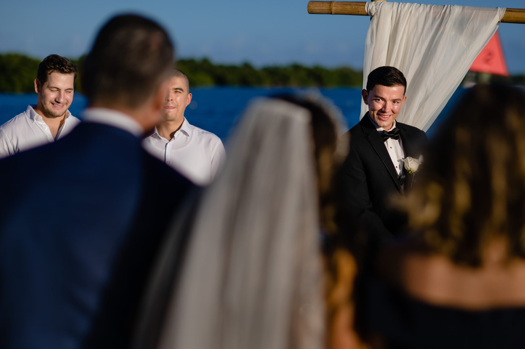 Groom first seeing his bride at a yacht club wedding in Key West.