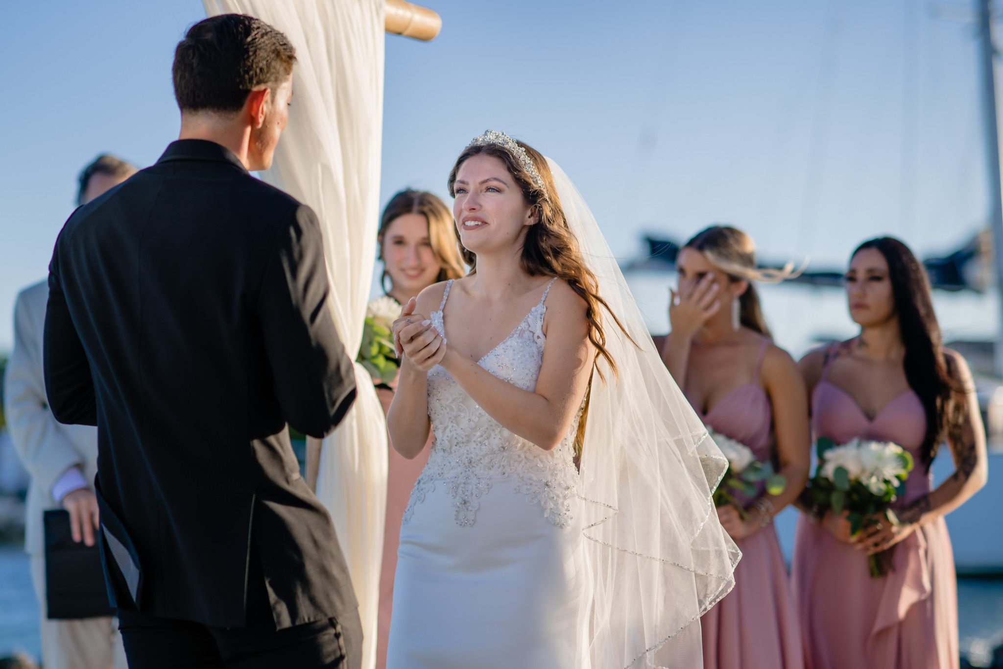 Bride saying her vows to her groom at a Key West wedding.