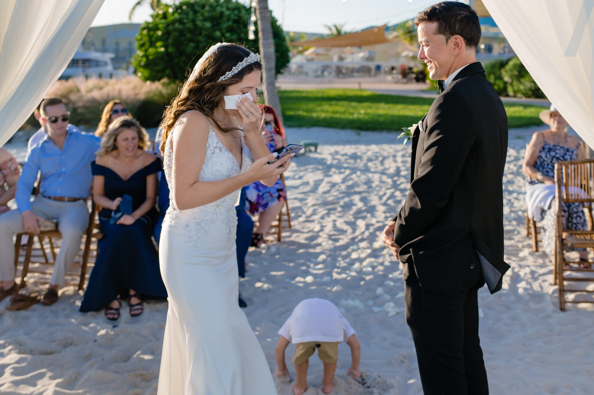 Bride wiping away her tears at her beach wedding in Key West.