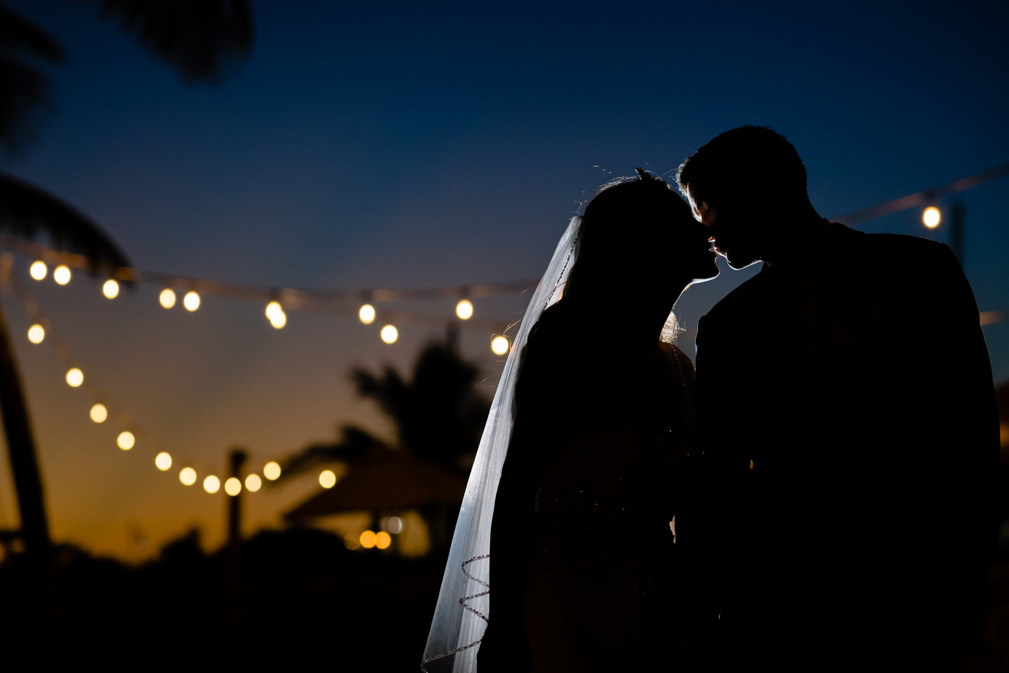 silhouette of bride and groom kissing on the beach in key west.