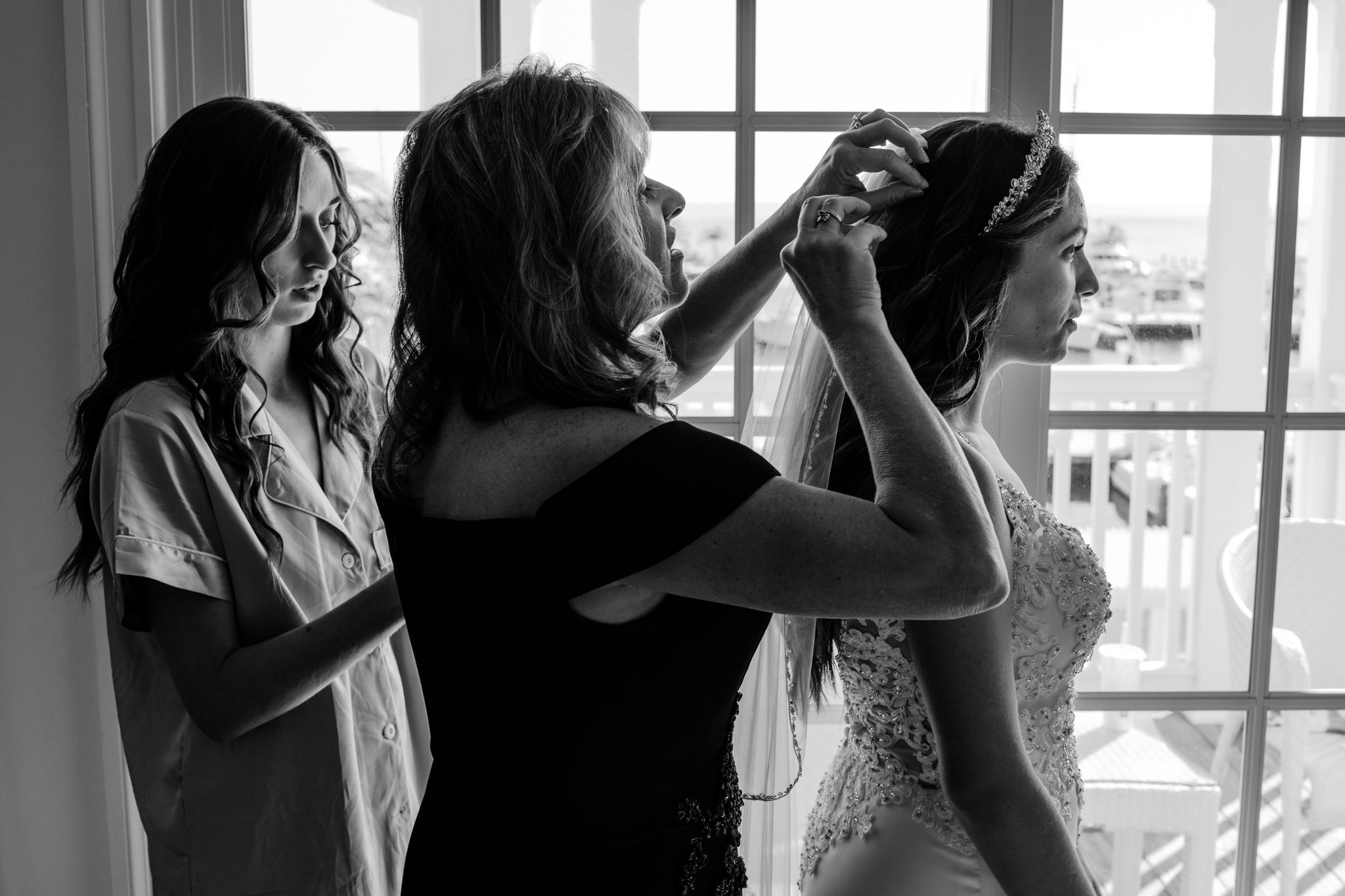 Maid of honor adjusting bride's hair for key west yacht club wedding.