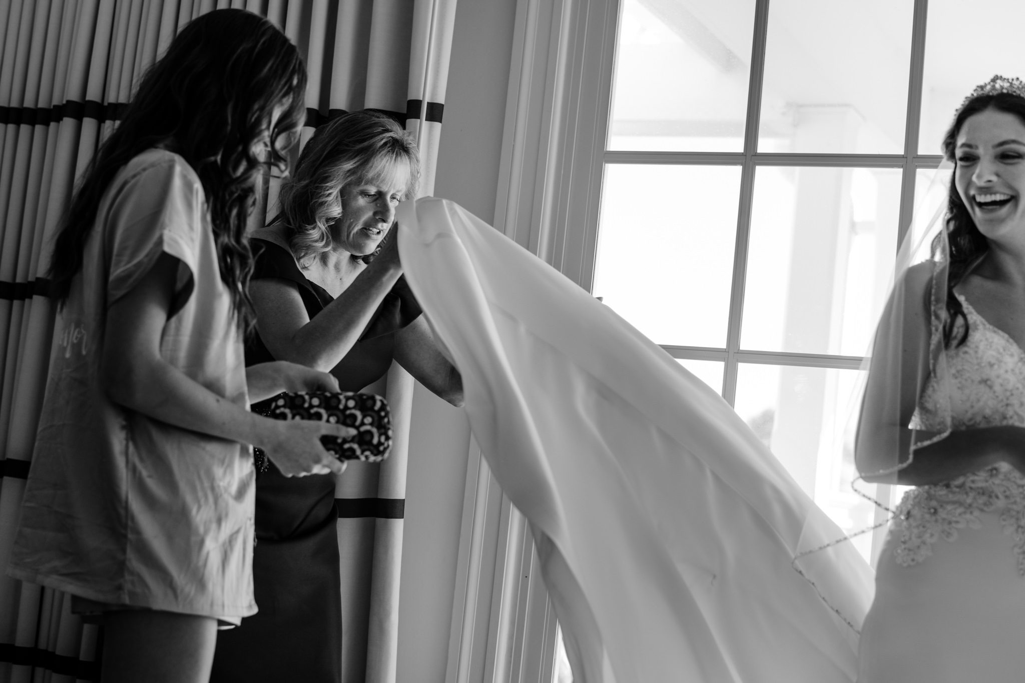 Woman holding bride's vail before wedding in key west.