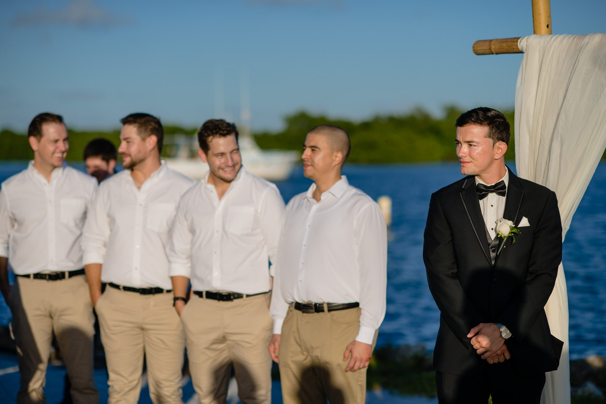 Groomsmen standing with ocean in the background at a key west yacht club.
