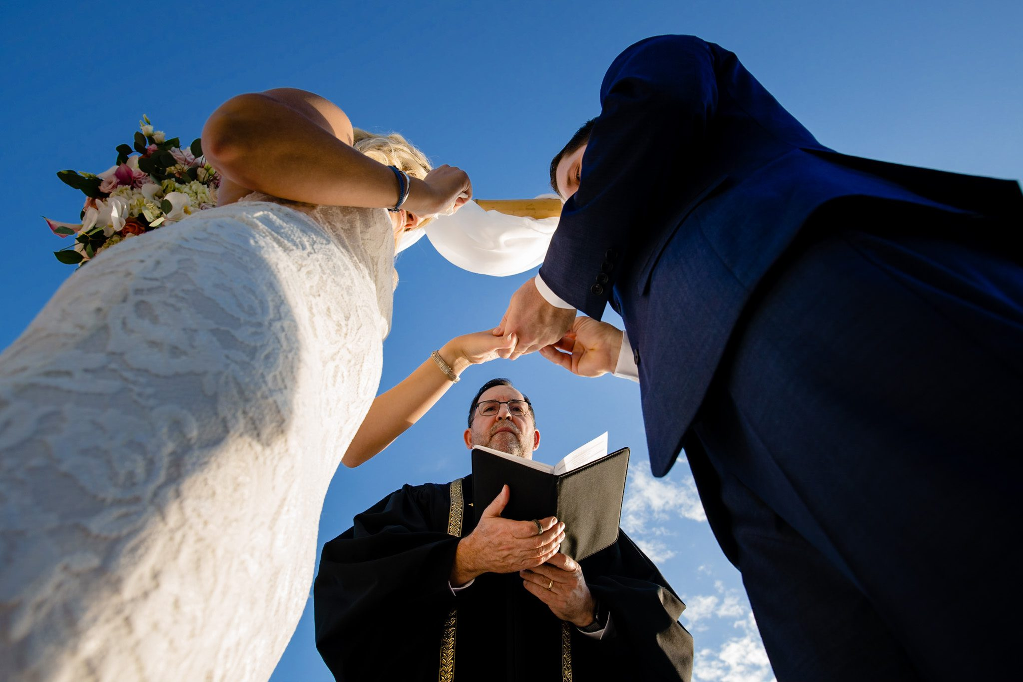 key west officiant marrying bride and groom at casa marina resort