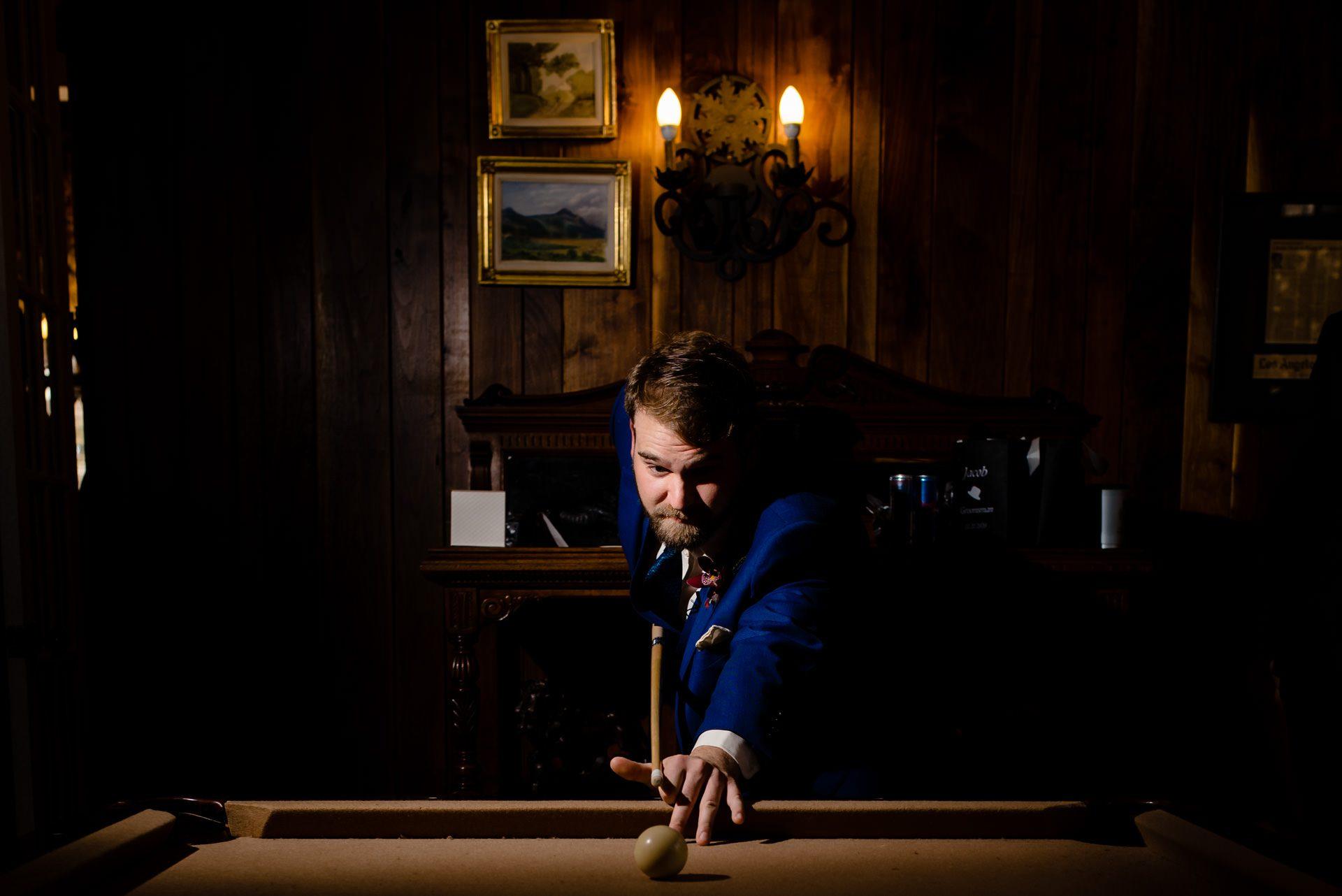 groom shooting pool before getting married