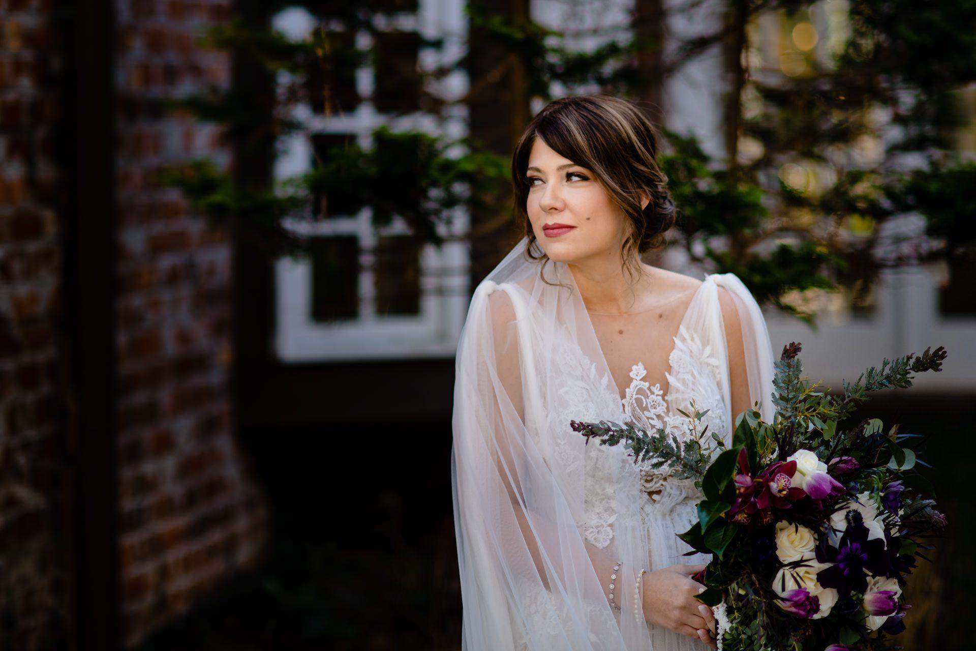 Bride looking over her shoulder before her wedding