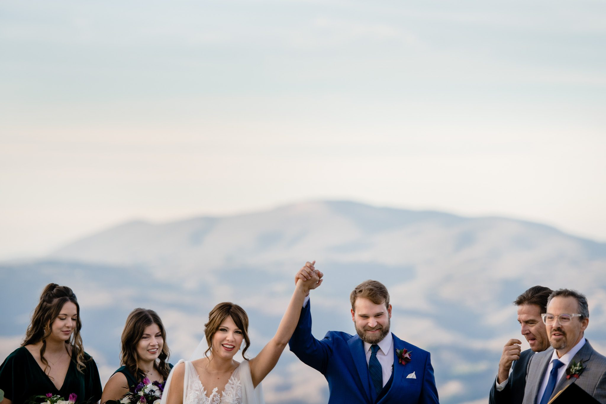 bride and groom celebrating just being married north carolina mountain wedding