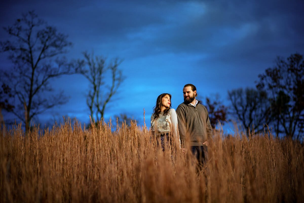 Engagment photoshoot of couple in a meadow