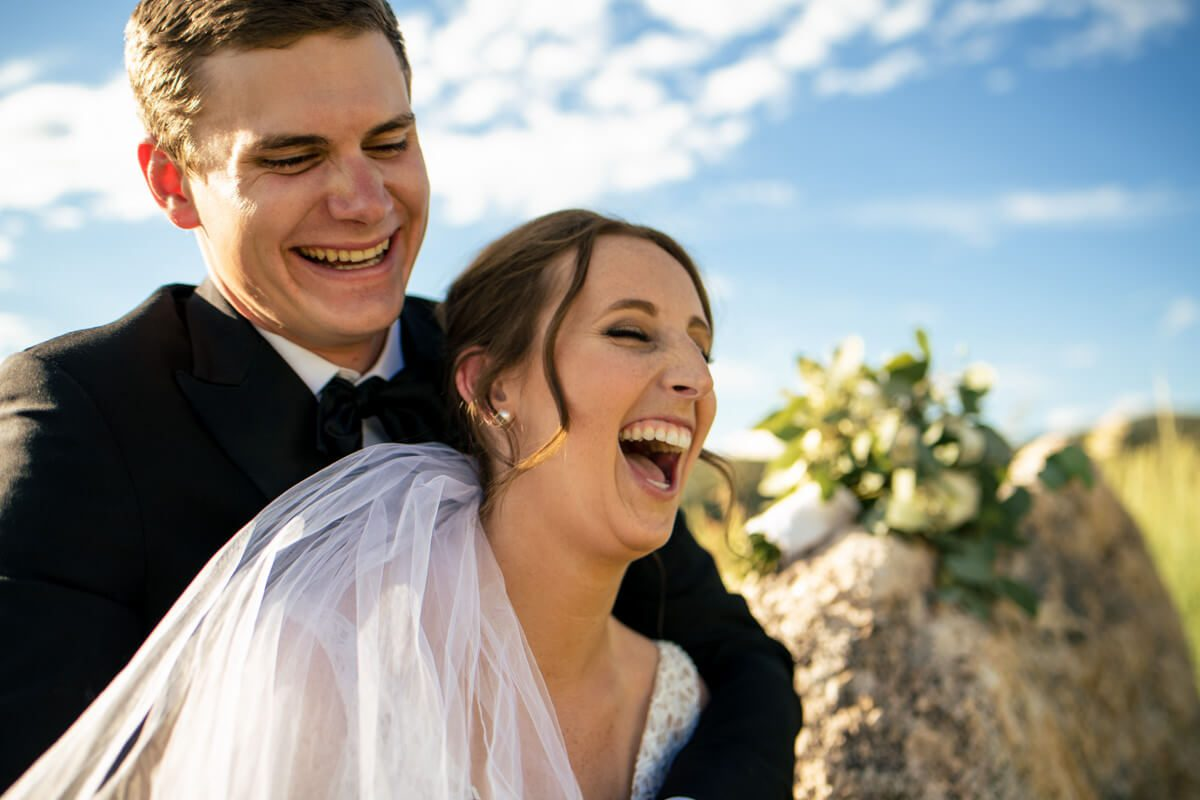 Couple smiling after elopement ceremony in asheville countryside