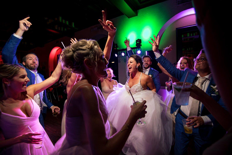 bride dancing with bridal party at casa marina wedding