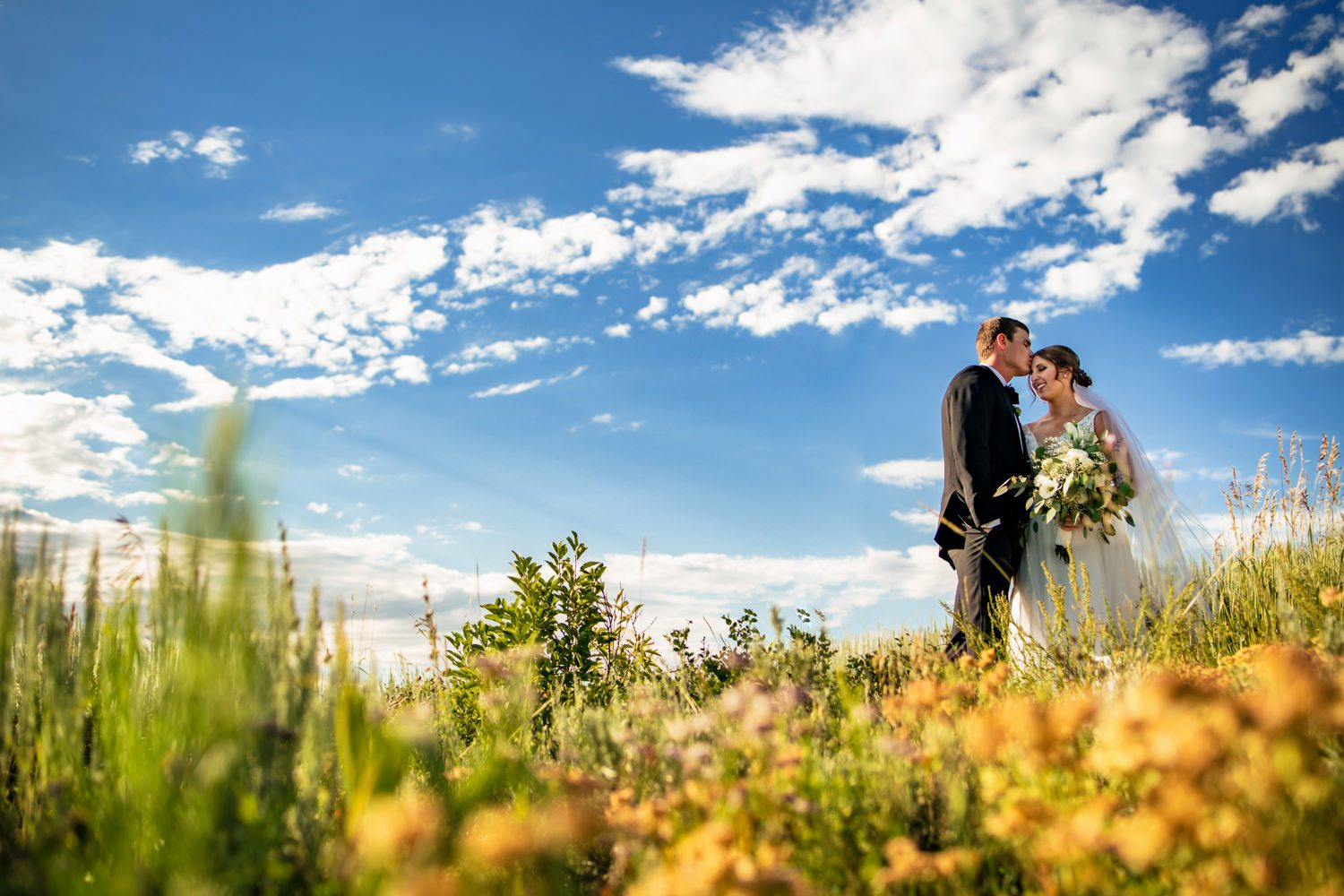 bride and groom during portraits at max patch in the blue ridge mountains
