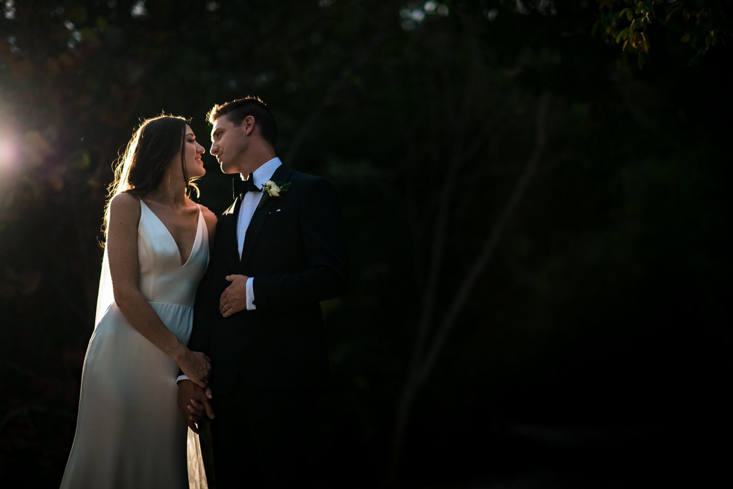 nighttime portrait of wedding couple in key west at fort zachary taylor